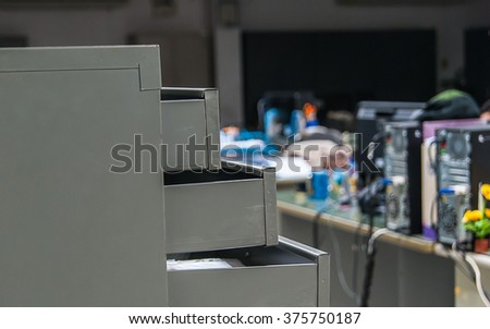 close up Photo of opened drawers in office - stock photo