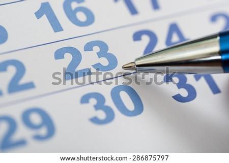 Close-up Photo Of Pen Nib On Calendar - stock photo