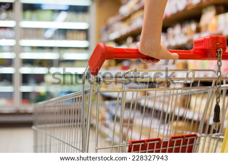 Close-up photo of shopping cart in supermarket - stock photo