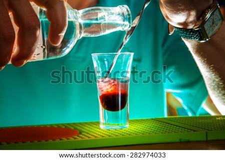 Close up photo of short cocktail in process of cooking. horizontal photo - stock photo