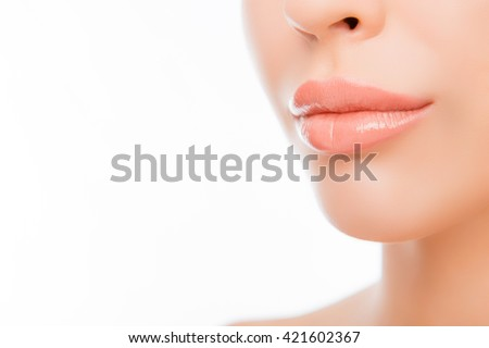 Close up photo of woman's lips with natural make up on white background - stock photo