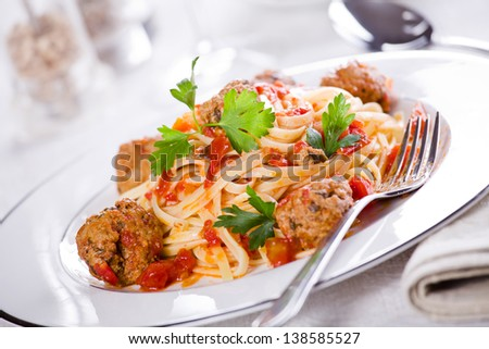 Close up photograph of a tasty meal of pasta with meatballs - stock photo