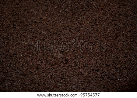 Close-up photograph of chocolate cake for use as an abstract background. - stock photo