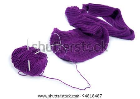 Close-up photos of the coil of purple yarn with knitting needles on the white background - stock photo