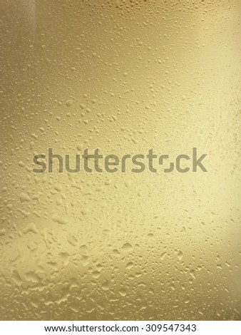close up pic of droplets of water on a champagne or white wine bottle  - stock photo