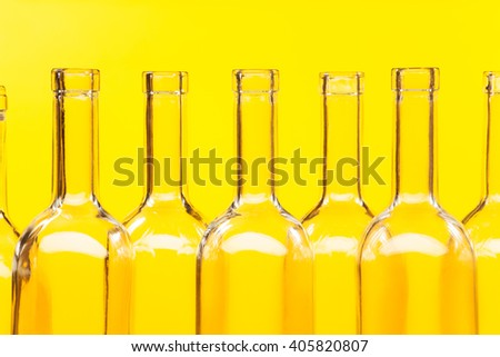 Close-up picture bottle necks with patch of lights - stock photo
