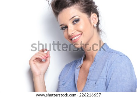 Close up picture of a beautiful young woman smiling and looking at the camera. - stock photo