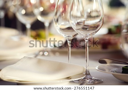 Close up picture of empty glasses in restaurant. Selective focus. - stock photo