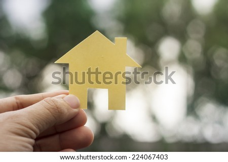 close up picture of hands holding house - stock photo