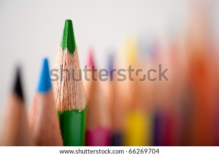 Close-up picture of multicolor pencils. Very shallow focus on green pencil - stock photo