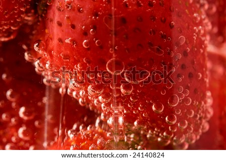 Close up picture of strawberries in glass with water - stock photo