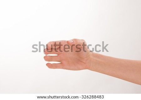 Close-up picture of woman's hand as if it is holding a bottle. It is nice idea for advertising any fashionable and popular drink. - stock photo