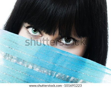 Close up picture of  woman wearing a veil on a white background. - stock photo