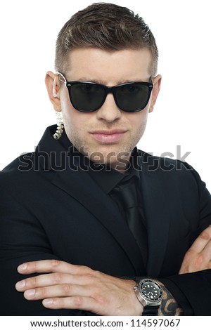 Close up picture of young smart bouncer looking at camera - stock photo