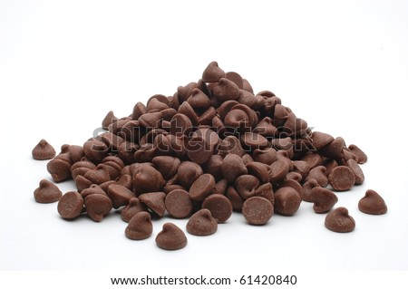 close up pile of chocolate morsels on white background - stock photo