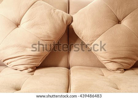 Close-up pillows and sofa seat - stock photo