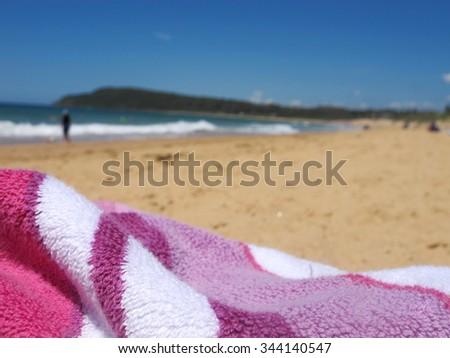Close up Pink Towel on Beach 2 - stock photo