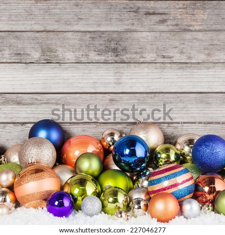 Close up Plenty of Attractive Christmas Balls in Different Sizes on Wooden Wall Background - stock photo