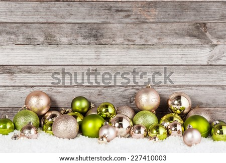 Close up Plenty of Stunning Green and Brown Christmas Ball Ornaments for Holiday Season with Vintage Wall Background. - stock photo