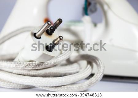close up Plug form the iron burned overload - stock photo