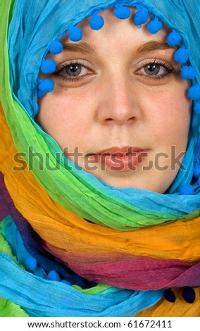 Close-up portrait a woman with a colored vell, arabic style - stock photo