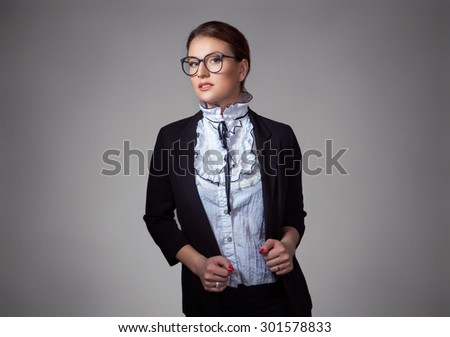 Close up portrait confident business woman in formal dress code holding suit jacket looking at you camera isolated grey background wall. Positive human emotions facial expressions life perception - stock photo