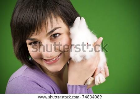 close up portrait girl holding rabbit on hand - stock photo