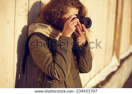 Close-up portrait girl photographer - stock photo