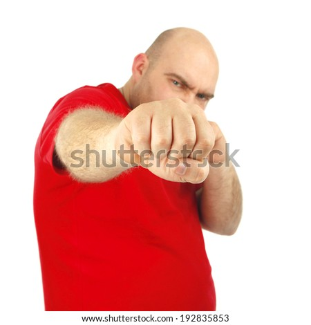 Close up portrait of a aggressive man showing his fist. Isolated Background - stock photo