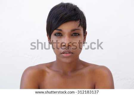 Close up portrait of a beautiful african american woman with modern hairstyle - stock photo
