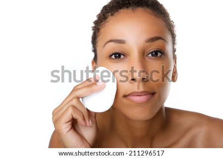 Close up portrait of a beautiful black woman removing make up - stock photo