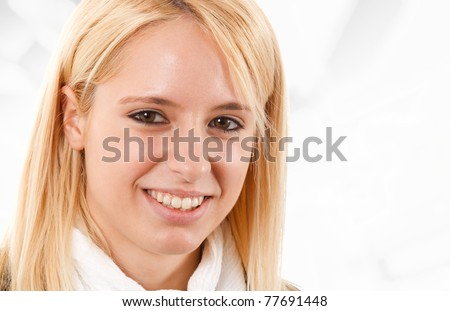 Close-up portrait of a beautiful blonde teenager. - stock photo