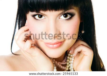 Close-up portrait of a beautiful brunette - stock photo