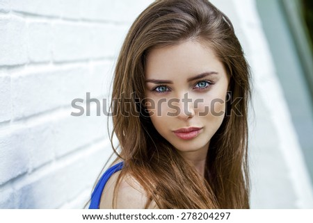 Close up portrait of a beautiful brunette woman, outdoors - stock photo
