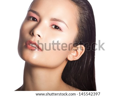 Close up portrait of a beautiful brunette woman with perfect glowing skin - stock photo