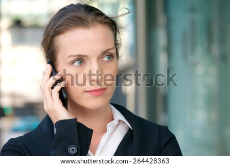 Close up portrait of a beautiful business woman listening to phone call on mobile - stock photo