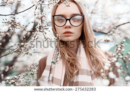 Close-up portrait of a beautiful girl in fashionable colors - stock photo