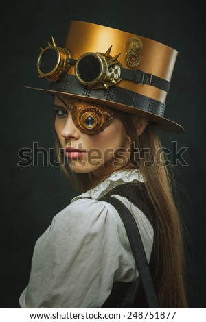 Close-up portrait of a beautiful girl steampunk, hat and eyecup - stock photo