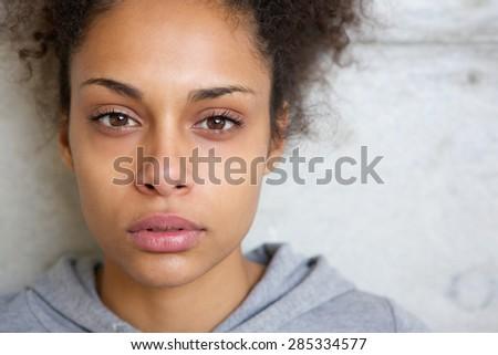 Close up portrait of a beautiful modern mixed race woman  - stock photo