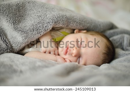 Close-up portrait of a beautiful sleeping baby. Cute infant kid. Child portrait. - stock photo