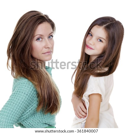 Close up portrait of a beautiful ten year old little girl and happy mother, isolated on white background - stock photo