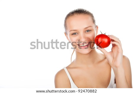 close-up portrait of a beautiful woman with a tomato,vegetarian food, smiled attractive caucasian girl holding tomato near face, woman eating ripe red juiced tomato,isolated on white - stock photo