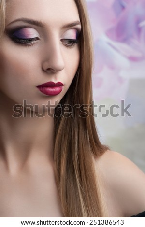 close-up portrait of a beautiful woman with closed eyes makeup - stock photo