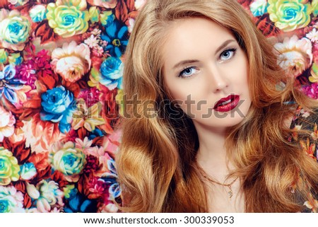 Close-up portrait of a beautiful young woman with magnificent blonde hair  and sensual lips. Beauty portrait, make-up, cosmetics. - stock photo