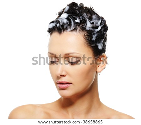 Close-up portrait of a beauty adult woman with shampoo on her hairs - stock photo