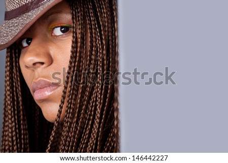 close-up portrait of a black woman in hat with copy space - stock photo