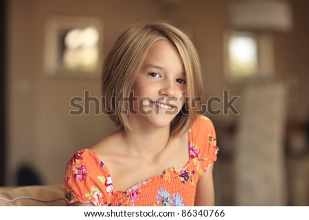 Close-up portrait of a blond teenager girl - stock photo