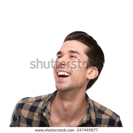 Close up portrait of a cheerful young man laughing on isolated white background - stock photo