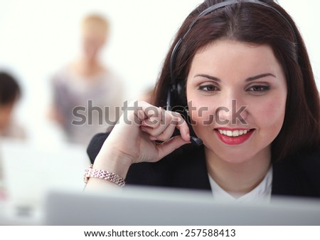 Close-up portrait of a customer service agent sitting at office - stock photo