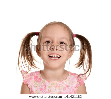 close-up portrait of a cute girl in a pink dress - stock photo